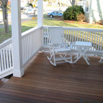 Decking And Painted Fir Railings Complement This Victorian