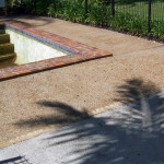Shabby Worn Pebblecrete Pool Surround Area Before New Coating Applied