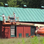 Workers Paint The Tin Roof Hen House