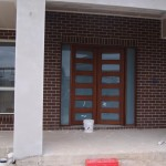 Front Doors Stained Jarrah First Coat