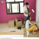 Couple Painting Interior Walls