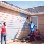Students Painting The House
