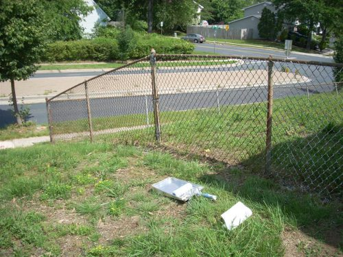 The Chain Link Fence Surrounding Back Yard Was Still Structurally