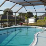 The Pool Deck Has Been Painted Was Light Gray Swirls