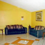 Yellow Wall Paint Odd Weird Floor Tile Pattern Blue Sofa Couch Bad Mls