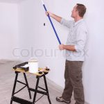 Man Painting Ceiling Roller
